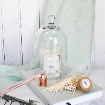 Scented candle with doe glass cover