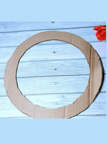 Step one to make a pom pom wreath from scratch