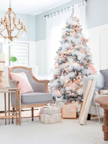White frosted Christmas tree decorating