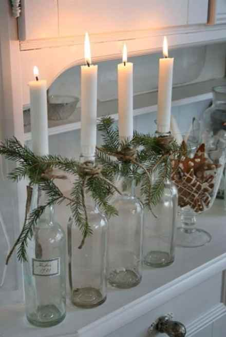 Handmade Scandinavian candle holder with empty bottle and chandelier candles