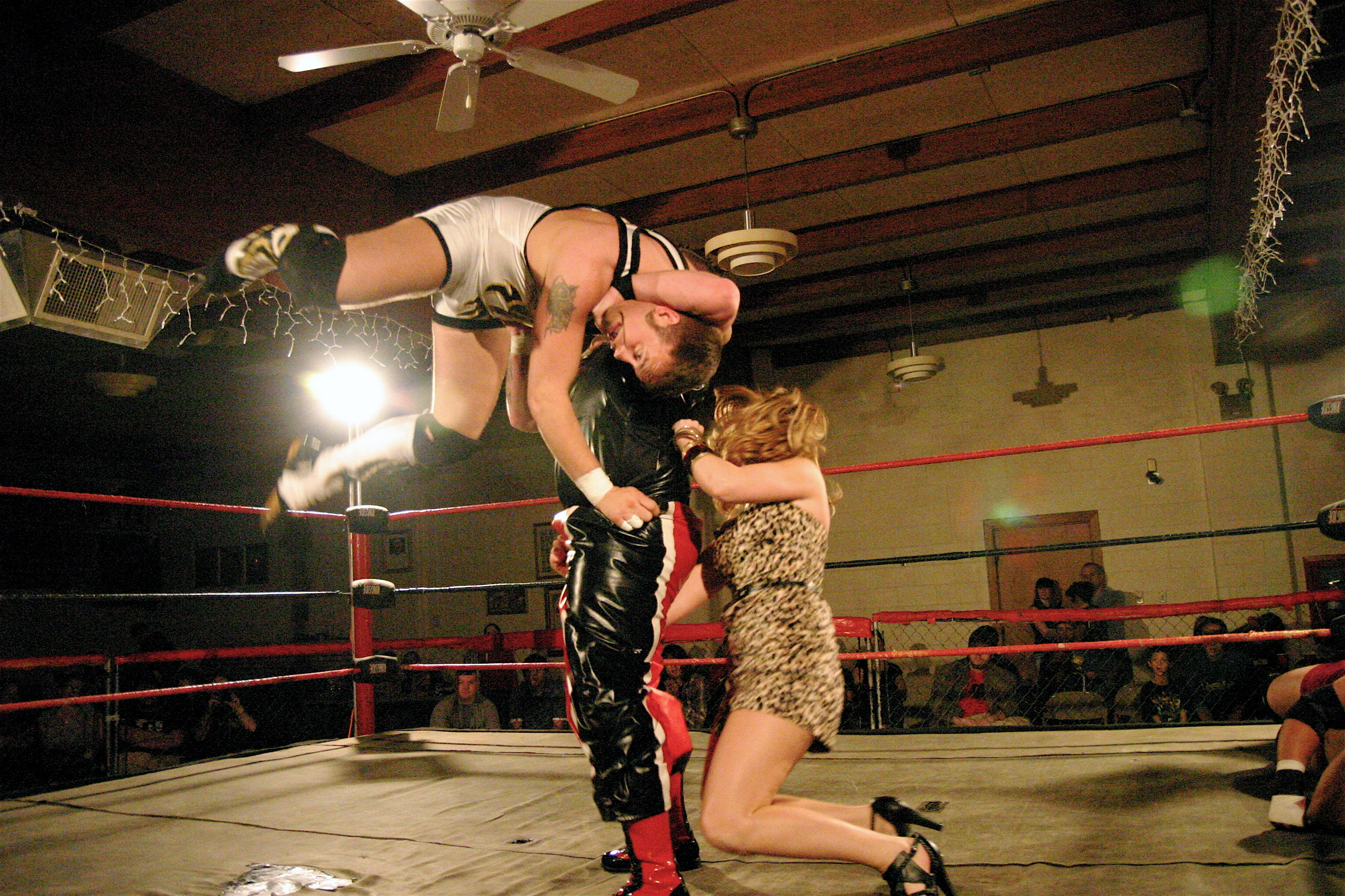 Tiffany LaFane goes low on Arik Cannon late in the match.  (Photo Credit: Michael R Van Hoogstraat)