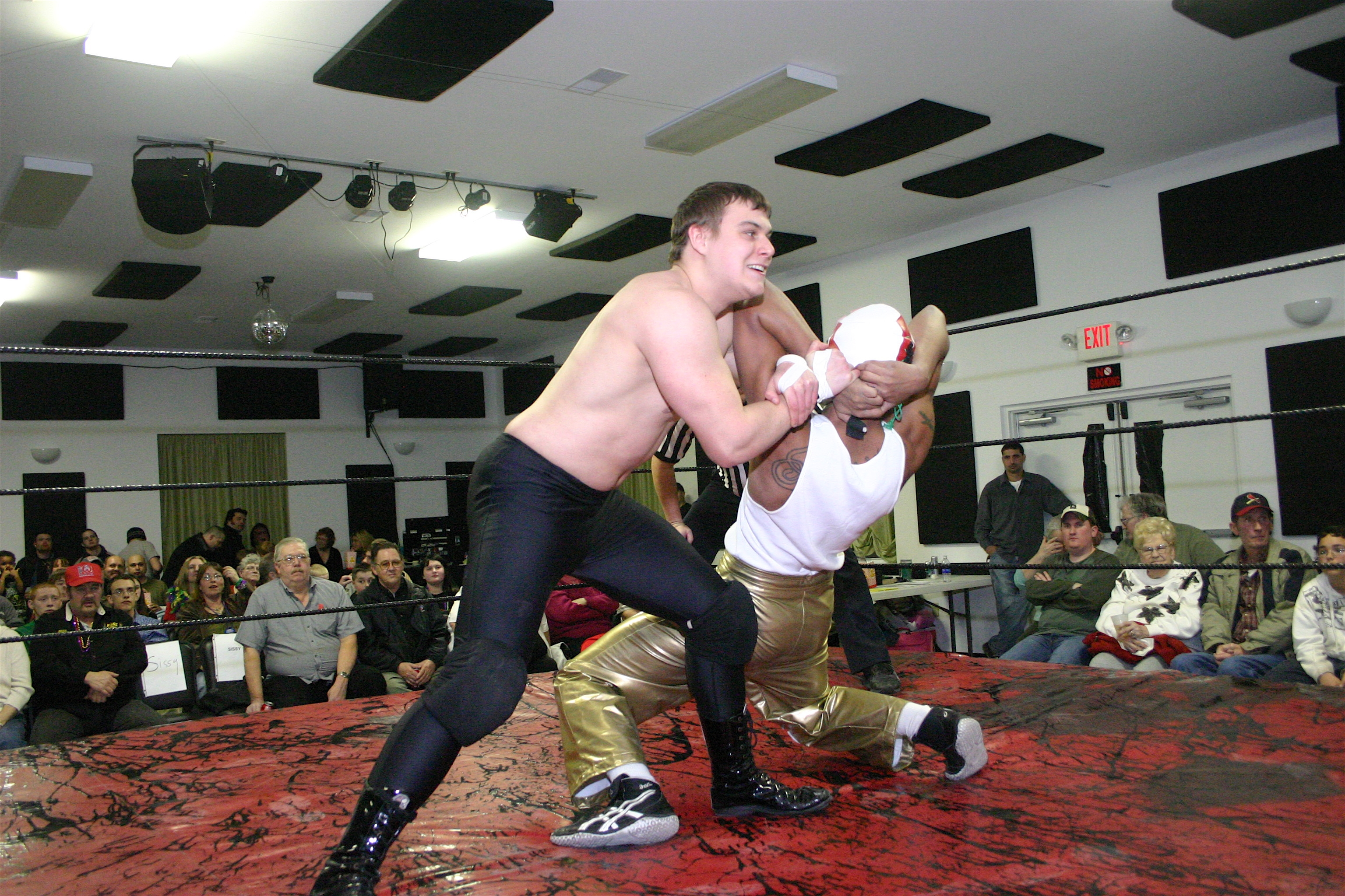 Junior Heavyweight Champion Dave Vaughn and Chucho have a test of strength. (Photo Credit: Michael R Van Hoogstraat)