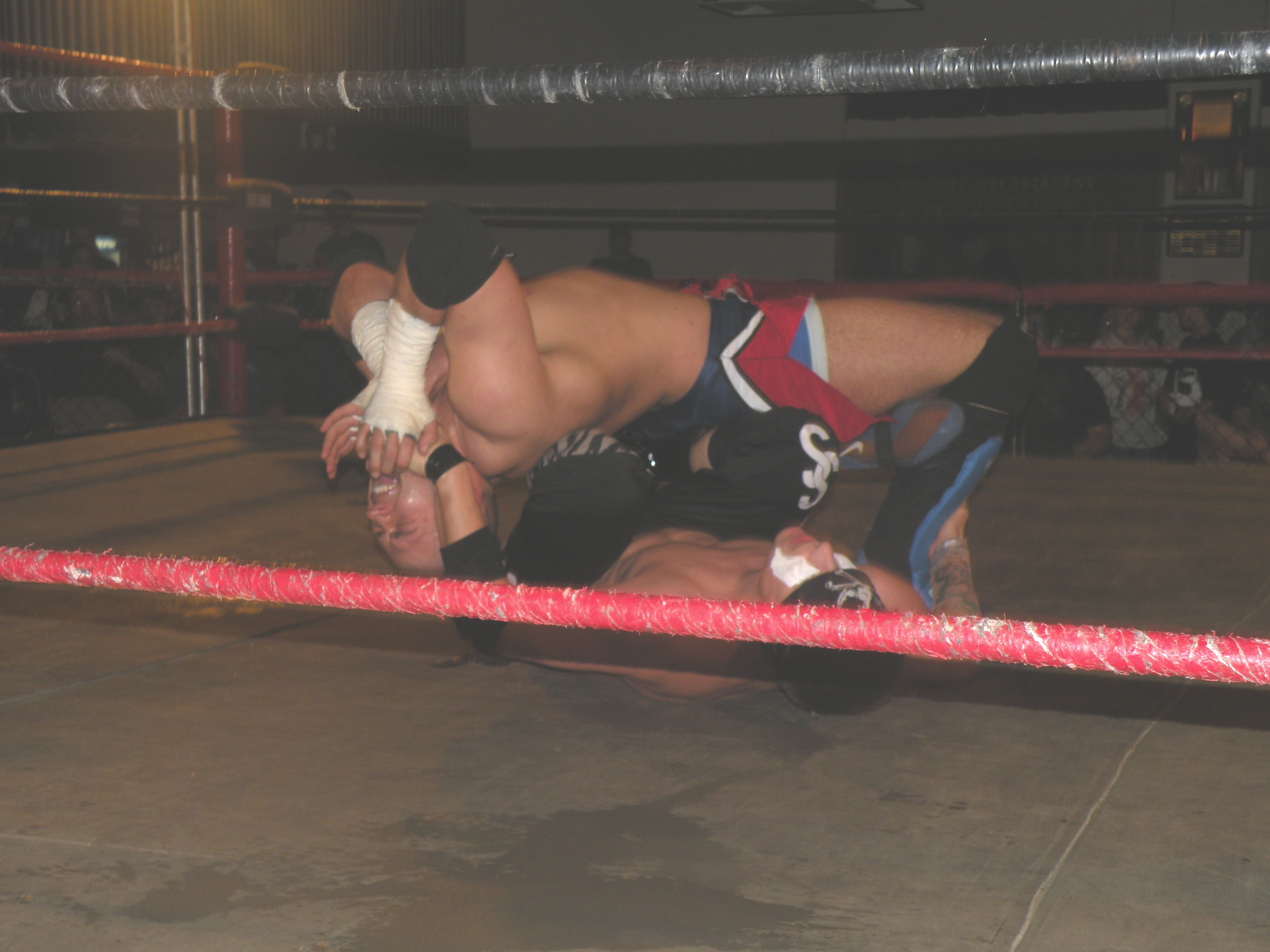 Evan Gelistico attempts to make Adam Raw quit before he even got out of the gate (Photo Credit:Brian Kelley)