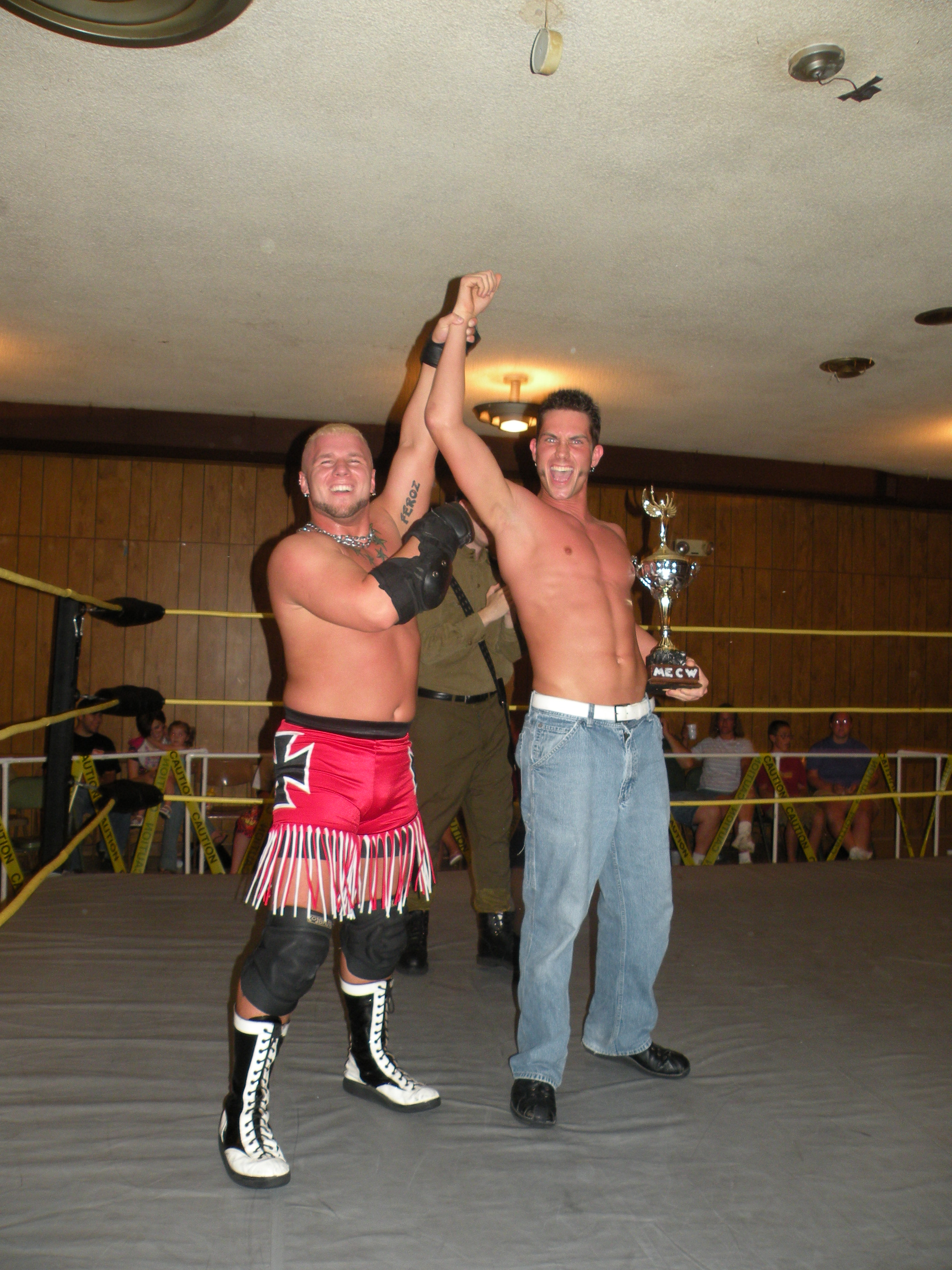 Bailey Mannix celebrates with the first ever MECW Great Plains Trophy Battle Royal Champion Ryan Slade
