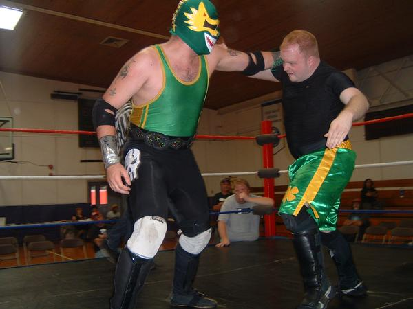 """Dragon Verde slugs it out with Conner Riley.(Photo Credit Brian """"Flair"""" Kelley)"""