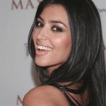 Kim Kardashian before hair extensions and fake lashes