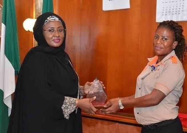 Aisha Buhari honours airport cleaner who returned lost bag