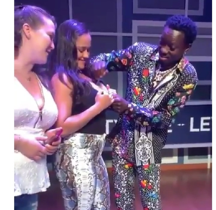 Ghanaian-American Actor, Michael Blackson Signs His Autograph On Women's Chests (Video) )