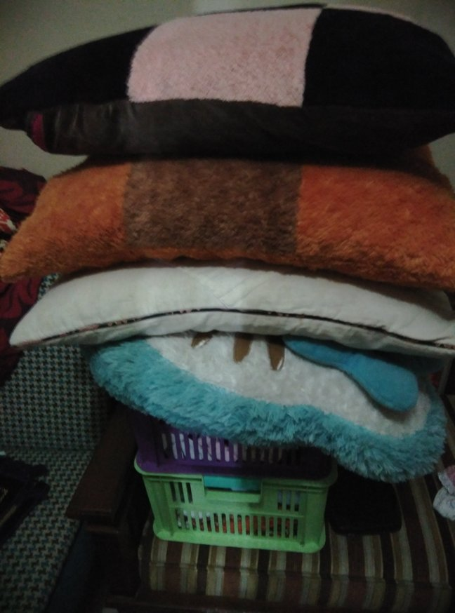 Stack of pillows also belong to Mom