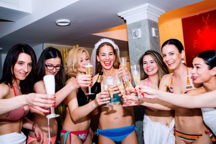 graphicstock-cheerful-bride-and-happy-bridesmaids-in-bikinis-celebrating-hen-party-with-champagne-women-enjoying-a-bachelorette-party_bdxse2drmw