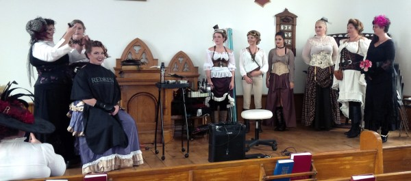 Victorian hairstyle demonstration by First Impressions Hair Design team