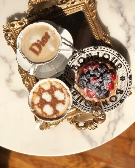 Marble table, gold baroque vintage antique tray, Anthropologie Bistro Collection Bonjour Plate, Dior Coffee, Gucci Coffee