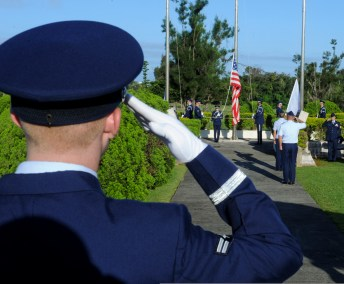 Air Force Airman saluting flag