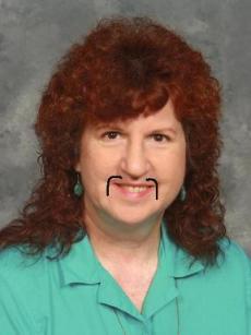 Kass's photo with fu manchu mustache drawn in