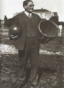 Dr. Naismith, holding a ball and a farm basket.