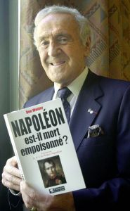 """Canadian doctor Ben Weider, president of the International Napoleonic Society, displays his book """"Was Napoleon poisoned ?"""" Friday June 1, 2001 in Paris. Weider presented to members of the Society and the press new results of toxicological analysis by Strasbourg's forensic laboratory on Napoleon's hair, tending to strenghten Weider's theory of an alleged death by arsenic poisoning of the French emperor. (AP Photo/Jacques Brinon)"""