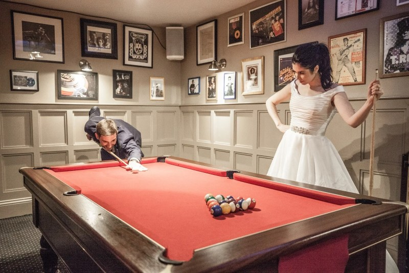 Bride and Groom play pool