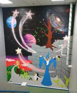 Mural depicting a wizard ram in a fantastical world with mystical creatures