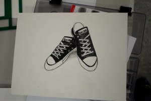 Drawing of Converse All-Star shoes in charcoal