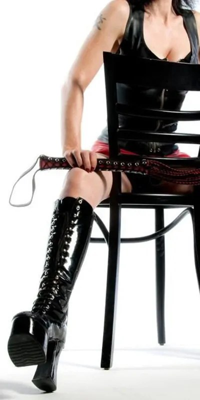mistress seated with whip