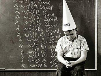 boy wearing dunce cap
