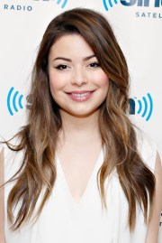 miranda cosgrove cuts teeth
