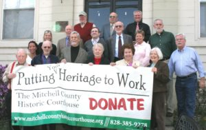 Mitchell County Historic Courthouse Foundation board members pose on the front steps to the building.