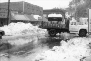 Dump trucks and a loader attempt to clear record amounts of snow from Oak Avenue in March of 1993.