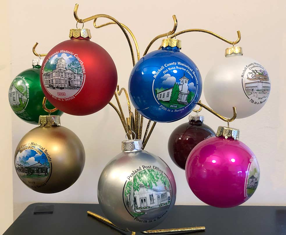 Photo of the 8 ornaments in a display