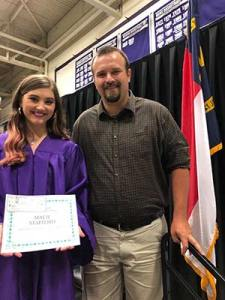 Macie Stafford with MCHS Board Member Brandon Dean Pittman