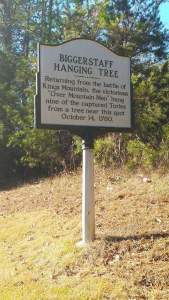 Photo of Historic Marker for the Biggerstaff Hanging Tree - Returning from the battle of Kings Mountaink, the victorious Overmountain Men hung nine of the capturied Tories from a tree near this spot on October 14, 1780