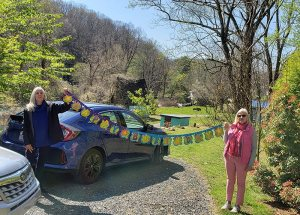 Photo of Sherry Weeks and Jan Graham with a birthday banner