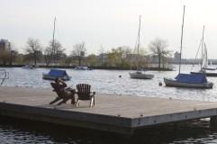Enjoying watching sail boats in the Charles River