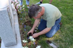 My husband planting marigolds at his mother's grave