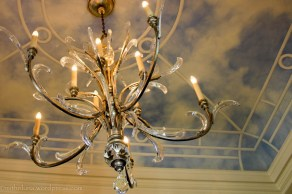 Ornate chandelier and painted ceiling