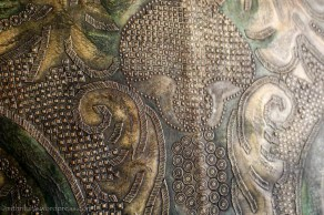 Detail - tooled leather covered wall