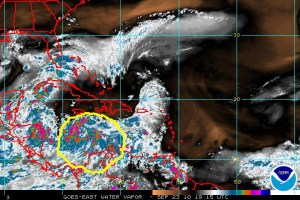 GOES satellite view of the larger Caribbean basin on 23 September 2010 showing the large amount of water vapor and precipitable water in the atmosphere over a large region around Tropical Depression #15, which is identified by the solid yellow outline.