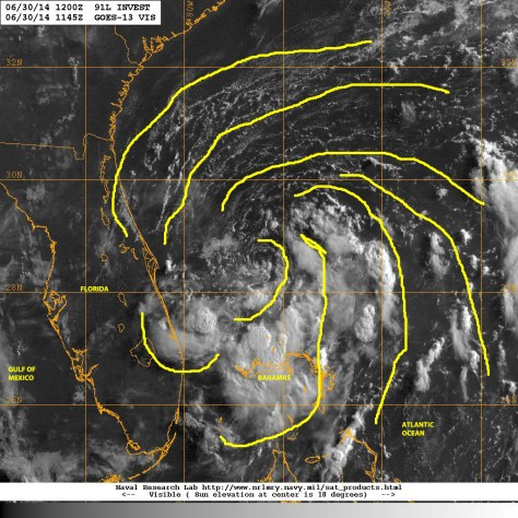 Visible light satellite image of 30 June 2014 in the morning showing the low pressure system off the east coast of Florida slowly moving SSW, showing some spiraling of rain bands toward the center of low pressure