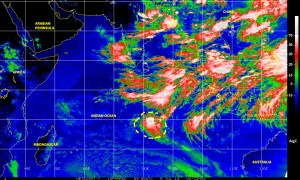 Color-enhanced infrared satellite image (NOAA) of 5 Julky 2014 showing a well defined low pressure system with cyclonic characteristics in the central/southern Indian Ocean