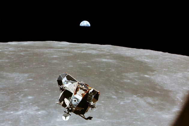 The Lunar Module 'Eagle' ascending back to the orbiting 'Columbia' module, with astronauts Armstrong and Aldrin aboard. A 'half Earth' rises above the Lunar horizon...a 'pale blue dot' we all call home!