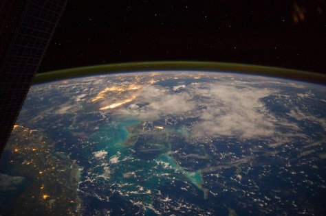 Nocturnal view of Southeast Florida from the International Space Station. The picture is looking northward. The bright island of light just left and above the center is  the Miami urban region. Beyond it the lighta od urban centers in Central Florida and on the Gulf Coast are also visible. Toward the lower left corner we see the lights of uerban centers in Cuba.