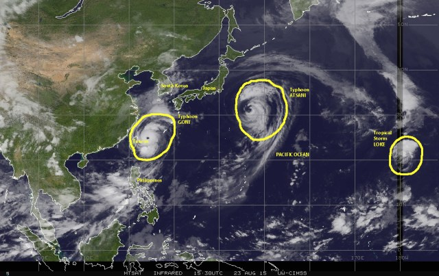Infrared satellite image of 08/23/2015 showing three tropical cyclones active today from the central Pacific to the extreme northwest Pacific