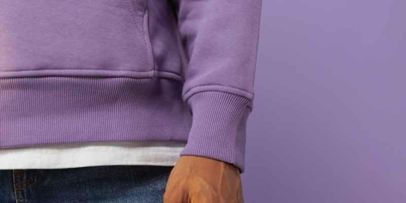 a person wearing a purple jacket