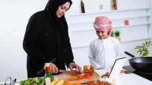 Arabic child in kitchen with mother