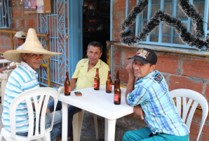 Locals enjoying beer on our way to the District 13 - Escalaras