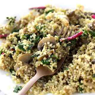 Swiss chard and mushroom quinoa with gold fork