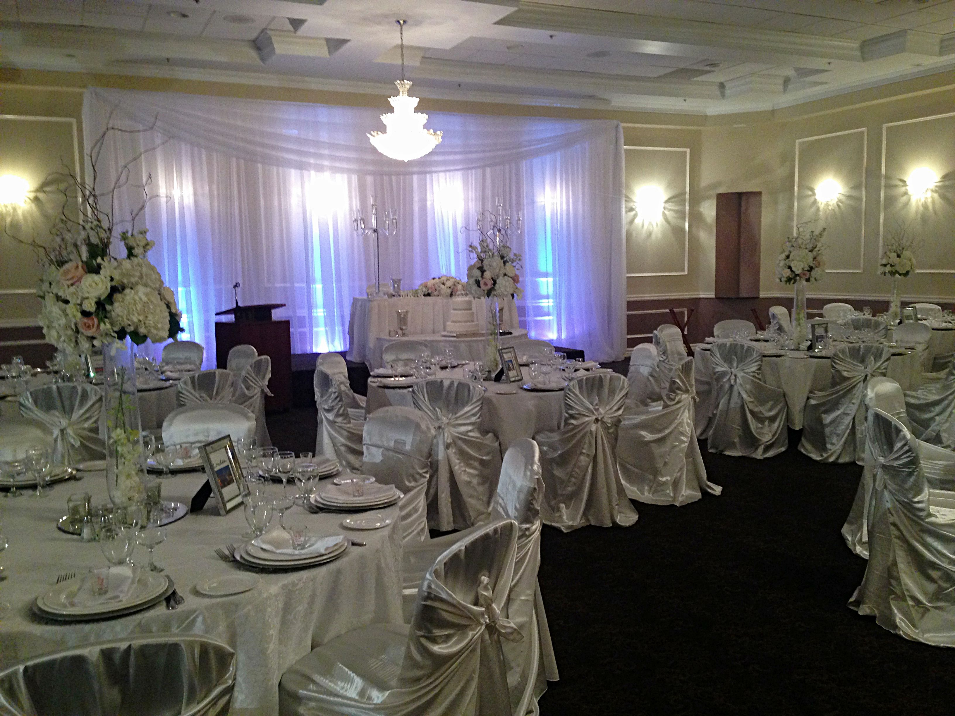 Elegant white and silver wedding reception setup