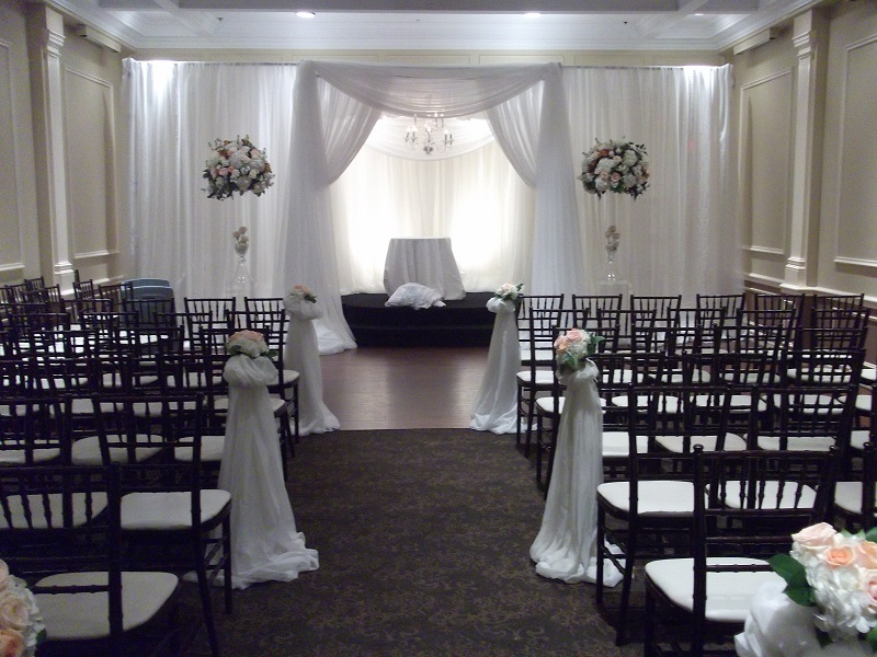 A lovely draped white chuppah for this traditional Jewish wedding