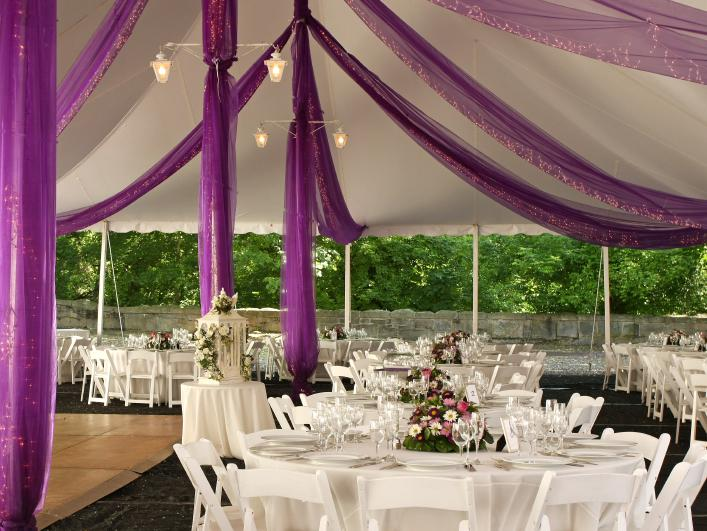 This wedding reception was held outdoors under a large open tent