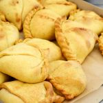 Kosher Jamaican Beef Patties Source: Jamaica Travel and Culture .com Ingredients-pastry 1 lb. flour 1/2 cup ice cold water 1/2 cup melted kosher margering 1/2 cup kosher shortening 1 tsp. salt 1 teaspoon of baking powder 1 teaspoon of curry powder 1 teaspoon of tumeric Ingredient- filling 1 lb. ground beef 1 medium onion 4 scallion 1/2 cup bread crumbs 1 tbsp chilli powder 2 cloves garlic 1 cup water 1 tsp. salt 1 tsp. pepper 1 tsp. paprika Pastry Sieve flour Stir in baking powder, curry powder. salt and turmeric. Work the margerine and shortening in with fingertips until mixture resembles breadcrumbs. Slowly drizzle in the water until the mixture has a dough like consistency. Roll the dough in to a ball. Wrap in cling film and place in the fridge for 1 hour. Filling Cut onion + scallion in to fine pieces Fry gently - so they do not quite get time to brown Add meat, thyme, garlic, peppers (finely chopped), salt, pepper, paprika, sugar and nutmeg Fry until mixture is fairly dry, drain off excess fat if necessary Add water and breadcrumbs, cook until the mixture has a thick, saucy texture Combining the pastry and filling Roll the pastry on a floured board until it is about 1/8 of an inch thick Cut as many circles (about the size of a saucer) out of the dough as you can. Place 1 tablespoon of the filling on one side of each pastry circle Moisten the edges of each patty with water and fold pastry over to make a crescent shape Seal the edge of each patty by crimping with a fork Cooking Preheat oven to 375 deg f, 200 C or gas mark 6 Place patties on aluminium foil Cook for 35 minutes (or until golden brown) Mitzuyan is one of the few Kosher catering Toronto companies that is able to transform non-kosher recipes to kosher delight
